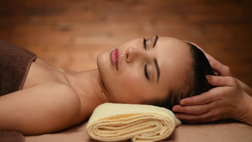 woman having relaxing spa treatment